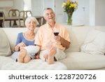 senior couple having popcorn... | Shutterstock . vector #1228720726