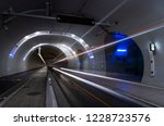 bus driving in a tunnel for... | Shutterstock . vector #1228723576