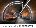 bus driving in a tunnel for... | Shutterstock . vector #1228723579