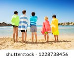 friends wrapped in beach towels ... | Shutterstock . vector #1228738456