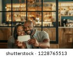 smiling young african couple... | Shutterstock . vector #1228765513