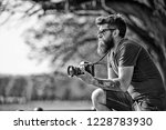 bearded man works with vintage... | Shutterstock . vector #1228783930
