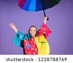 enjoy rainy weather with proper ... | Shutterstock . vector #1228788769