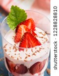 strawberries with yogurt in a... | Shutterstock . vector #1228828810