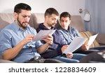 three young men in serious...   Shutterstock . vector #1228834609