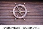 wooden ship steering wheel... | Shutterstock . vector #1228857913