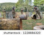 paintball players aiming and... | Shutterstock . vector #1228886320