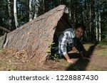 a wickiup to shelter hunters... | Shutterstock . vector #1228887430