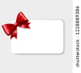 blank gift tag red ribbon bow... | Shutterstock .eps vector #1228889386