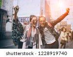 couples of asian traveller... | Shutterstock . vector #1228919740