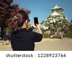 woman tourist taking a photo of ... | Shutterstock . vector #1228923766