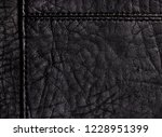 black leather background with... | Shutterstock . vector #1228951399