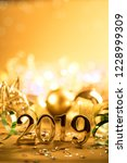 new year closeup golden 2019... | Shutterstock . vector #1228999309