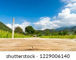 the walk way by bamboo bridge... | Shutterstock . vector #1229006140