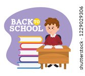 boy student in the desk with...   Shutterstock .eps vector #1229029306