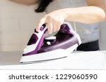hand holding iron close up ... | Shutterstock . vector #1229060590