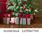 christmas tree with gift boxes  ... | Shutterstock . vector #1229067703