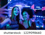 cropped shot of two young... | Shutterstock . vector #1229098660