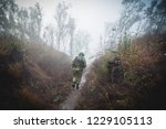 soldier goes through the woods | Shutterstock . vector #1229105113