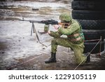 soldier fires a machine gun | Shutterstock . vector #1229105119