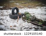 soldier shoots from a sniper... | Shutterstock . vector #1229105140