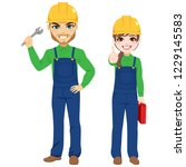 male and female workers holding ... | Shutterstock .eps vector #1229145583