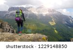 hiker with backpack relaxing on ... | Shutterstock . vector #1229148850