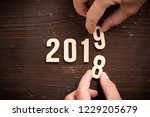 hand changing a wooden number   ... | Shutterstock . vector #1229205679