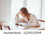 tired caucasian girl in white... | Shutterstock . vector #1229215549