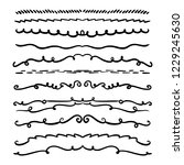 collection of handdrawn swirls... | Shutterstock .eps vector #1229245630