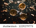 three glasses of champagne on... | Shutterstock . vector #1229279773