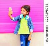 happy smiling child taking... | Shutterstock . vector #1229298793