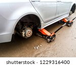 the car is at the tire shop.... | Shutterstock . vector #1229316400
