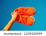 sports shoes sneakers on blue... | Shutterstock . vector #1229320399