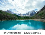 mountain lake is surrounded by... | Shutterstock . vector #1229338483