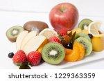 various fruits on plate | Shutterstock . vector #1229363359