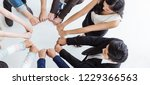 creative team meeting hands... | Shutterstock . vector #1229366563