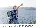 handsome smiling hiker guy is... | Shutterstock . vector #1229380300