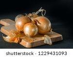 onions on wooden board   Shutterstock . vector #1229431093