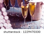 champagne bottle in bucket with ... | Shutterstock . vector #1229470330