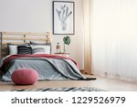 pink pouf in front of grey... | Shutterstock . vector #1229526979
