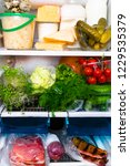 open refrigerator filled with... | Shutterstock . vector #1229535379