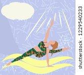 the girl doing yoga asana on...   Shutterstock .eps vector #1229540233