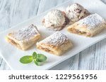 slices of apple strudel on the... | Shutterstock . vector #1229561956