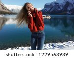 happy woman smiling near the... | Shutterstock . vector #1229563939