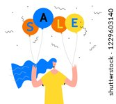season sale poster. woman with... | Shutterstock .eps vector #1229603140