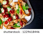 bruschettas on a silver tray on ... | Shutterstock . vector #1229618446