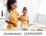 happy african american mother... | Shutterstock . vector #1229623549