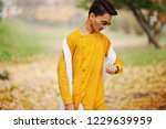 indian stylish man in yellow... | Shutterstock . vector #1229639959