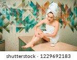 young woman applying scrub... | Shutterstock . vector #1229692183